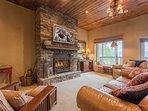 Downstairs den with gas log fireplace, TV, game room, bar