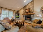 Meadow View living room with wood-burning fireplace, TV
