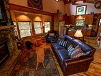 Grandfather View Cabin living room with fireplace and tv