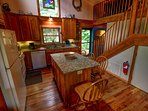 Grandfather View Cabin kitchen fully stocked as you enter home