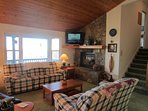 Mountain Sunrise Living Room with Stone Wood Burning Fireplace, Flat Screen TV and VIEWS!