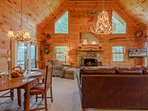 Great Room and Dining Area boast Vaulted Ceilings, Antler Chandeliers, and Lots of Room to Relax!