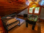 Cloud 9 Upstairs loft area with 3 twin beds and foosball table