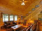Deer Run Living Room with Leather Furniture, Gas Stone Fireplace, and Large Flatscreen TV