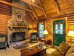 Cromartie House Stone Fireplace, Log Beams, Lots of Seating and Open to Wraparound Decks