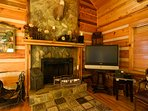 Stone Fireplace and Flatscreen TV in Living Room