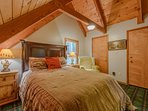 Queen Bedroom Upstairs with Vaulted Ceilings and Exposed Beams