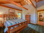 King Bedroom Upstairs with Vaulted Ceilings and Exposed Beams