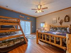 Wildlife Manor Bedroom sleeps 5 with queen log bed & separate twin over full bunk. This Room is on the same level as...