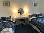 Ground floor bedroom with small double and single beds