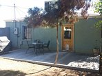 Shaded, backyard, with a six foot block wall. Great for pets! And a BBQ dinner, with friends.