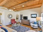 Stucco, post & beam wood ceilings, hardwood & tile flooring highlight the space.