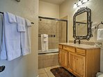 Utilize the shower/tub combo found in the second en-suite bath.