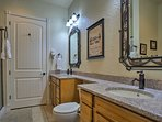 The master en-suite features a his-and-hers vanity.