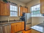 Ample granite counters ensure plenty of space for meal preparations.