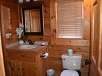 Bathroom with full size walk in shower and washer/dryer combo.