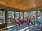 The peaceful screened porch offers a great spot to unwind.