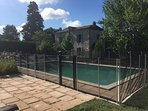 Removable pool fence provided
