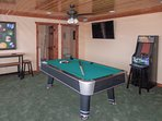 Brush up your pool skills at the full-size billiards table.