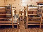 Traditional twin-over-twin bunk beds complete this 6th bedroom.