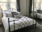 King size bed with ensuite shower room on first floor