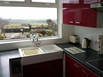 Well equipped kitchen with dishwasher and far reaching sea views