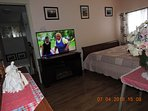 Master bedroom has a 47 in TV on an electric fireplace stand