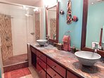 Ocean View Master Bedroom: Blue Oasis Washroom with Dual Sinks and Showers