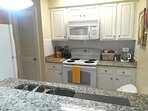Spacious kitchen with granite countertop and all of your cooking needs