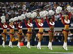 Dallas Cowboys Cheerleaders in their Christmas Uniform performing at AT&T Stadium