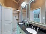 Roomy bathroom with large shower with customer tile