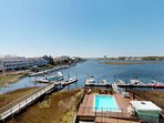 Enjoy the fantastic Pelican Pointe views overlooking the CB Yacht Basin and the community pool