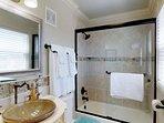 Guest room has a spacious private bathroom