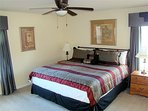 Upstairs master, with en-suite bathroom with Shower stall and tub. Huge comfortable King Size Bed