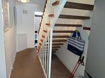 Understairs storage and coat hooks