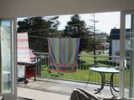 Detachable dual line clothes line on patio area.