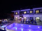 Nightscene showing our lovely swimming pool and ground floor aparts