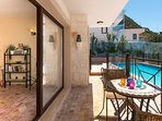 Covered private patio features a lockable gate for families