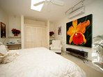 2nd master bedroom with king bed and original art work