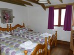 Wagon House twin bedroom which is on the ground floor. Wardrobe and dressing top with mirror