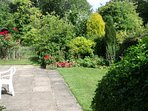 A tranquil haven of peace - relax in the company of birds and bees as they flit among the foliage.