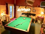 Pool table in the basement with futon for sleeping, darts, TV with dvd and Roku & gaming system