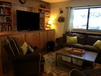 TV room with accordian door for privacy. Pull out couch sleeps two