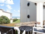 The balcony offers a view of the ocean.