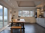 Large dine in kitchen with patio window to terrace
