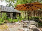 There's a second patio with an outdoor dining table, umbrella & chairs.