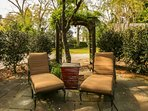 Enjoy your morning coffee on the patio's lounge chairs.