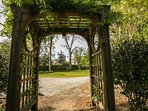 The pergola on the end of the patio leads to the private driveway and backyard.