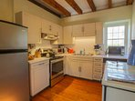 A fully-equipped kitchen with dishwasher, refrigerator, oven, stove, microwave & coffee maker await you.