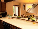 The breakfast bar is perfect for entertaining and to conveniently serve meals.